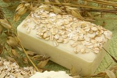 Oatmeal Soap. And ears of oats on a green towel Stock Photos