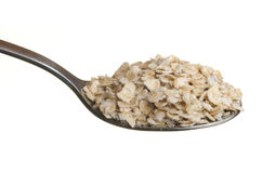 Oatmeal in a spoon Stock Images