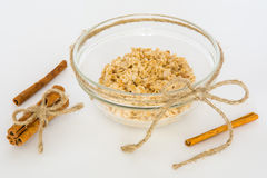 Oatmeal with a sticks of cinnamon on a white background Stock Images