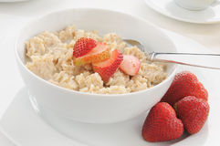 Oatmeal and strawberries Stock Image