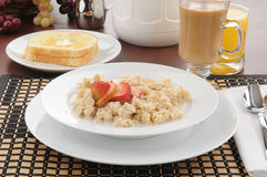 Oatmeal with strawberries and toast Stock Photo