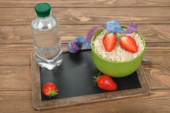 Oatmeal, strawberries and water Stock Image