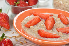 Oatmeal with strawberries Stock Photography