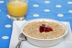 Oatmeal with strawberry jam and orange juice Stock Photography
