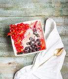 Oatmeal with strawberry puree and assorted berries and coconut, Stock Image