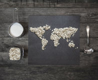 Oatmeal on the table in a shape of world map. Top view. Royalty Free Stock Images