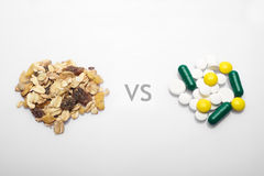 Oatmeal versus medicine Royalty Free Stock Image