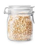 Oatmeal w szklanym słoju odizolowywającym na bielu fotografia stock