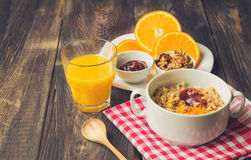 Oatmeal with walnuts, orange peel and jam for breakfast Royalty Free Stock Images