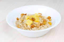 Oatmeal in a white bawl Royalty Free Stock Image