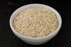 Oatmeal in white bowl Royalty Free Stock Image