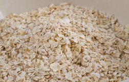 Oatmeal. White oats seeds in a cereal bowl royalty free stock image