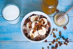 Free Oatmeal With Bananas, Raisins And Honey Stock Photos - 65373523