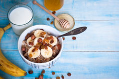Free Oatmeal With Bananas, Raisins And Honey Stock Photos - 65373593
