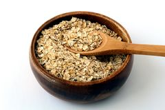 Oatmeal in a wood bowl. On white Stock Photos