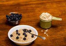 Oatmeal on Wood Tabel with Blueberries Stock Image