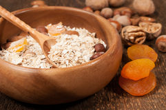 Oatmeal in a wooden bowl close up Royalty Free Stock Photos