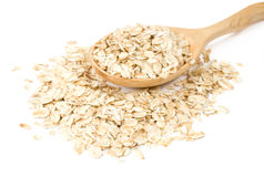 Oatmeal in a wooden spoon Stock Photo