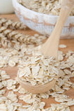 Oatmeal in a wooden spoon Stock Image