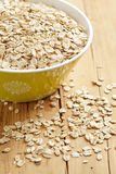 Oatmeal on wooden table Stock Photography