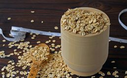 Organic rolled oats in a wooden bowl. royalty free stock photo
