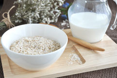 Oatmeal on wooden tray Stock Images