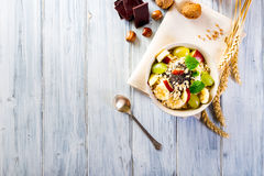 Oatmeal with yoghurt and fresh fruit. Royalty Free Stock Photography