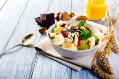 Oatmeal with yoghurt and fresh fruit. Royalty Free Stock Image
