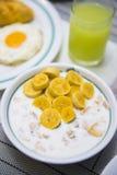 Oatmeal with yogurt and bananas for breakfast Stock Photos
