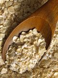 Oats #1. Oats with wooden spoon closeup Royalty Free Stock Photography