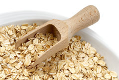 Oats. Seeds of oats with wooden spatula. Macro stock image