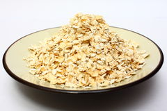 Oats. Bowl of uncooked oats on kitchen counter Royalty Free Stock Photos