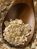 Oats #2. Oats with wooden spoon closeup Royalty Free Stock Photo