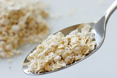 Oats. Spoon of oats Royalty Free Stock Photo