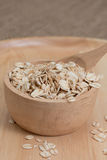 Oats in bowl on wooden plate Royalty Free Stock Photography