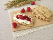 Oats crispbread with raspberry jam Royalty Free Stock Photo