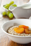 Oats and dried apricots Royalty Free Stock Image