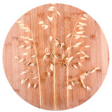 Oats ears. On round bamboo background Royalty Free Stock Photography