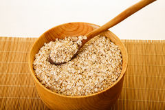 Oats In Wood Bowl On Bamboo Mat Royalty Free Stock Images