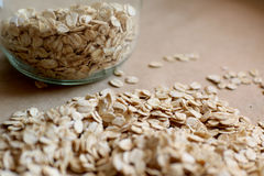 Oats in jar and background Stock Photos