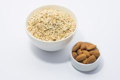 Oats milk and nut breakfast. Nutritionist Gargi Sharma says, `Oats are rich in soluble fibers which help in lowering cholesterol levels. These soluble fibers Stock Photo