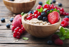 Oats with mix of berry on the wooden table Royalty Free Stock Photo