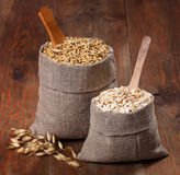 Oats and oat flakes in bags Royalty Free Stock Images