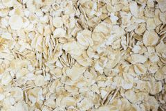 Oats and oatmeal in a container close up shot macro. royalty free stock photo