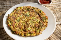 Oats omelette. Is a healthy and filling breakfast for diabetic friends. This healthy omelette can be served and loved by all age groups stock photos