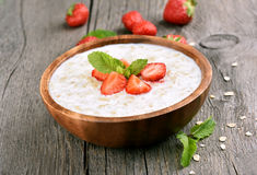 Oats porridge with fresh strawberry Stock Images