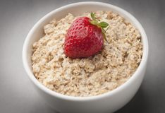 Oats. Pot with oats, milk and strawberries to use in product packaging stock images