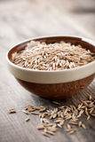 Oats. Raw oats in ceramic bowl Royalty Free Stock Images