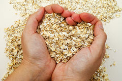 Oats shaping heart in woman hands Royalty Free Stock Image