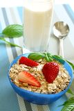 Oats and strawberry in bowl and glass of milk Royalty Free Stock Photo